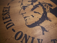 Berti Wood Flooring References: Diesel\'s logo with inlaid parquet - Custom made laser inlay parquet